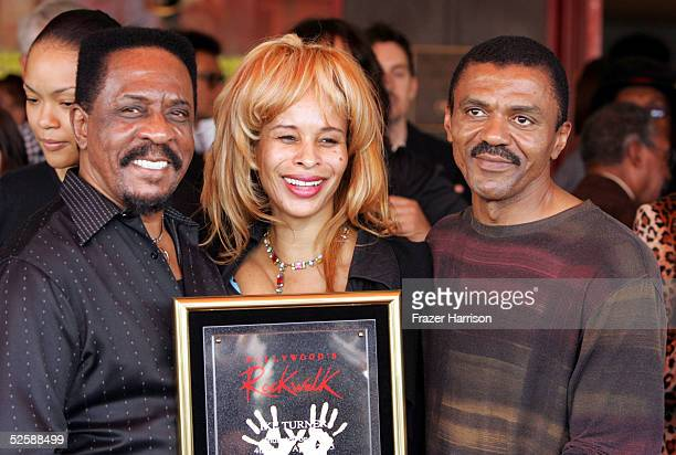 Musician Ike Turner stands with guest Audrey Madison and Ike Turner Jr. After he was inducted into the Hollywood Rockwalk along with Muddy Waters,...