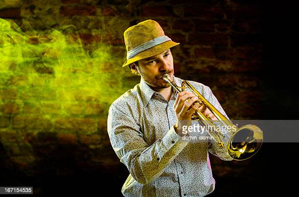 Musician is playing on the trumpet on stage, jazz concert