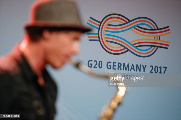 A musician is seen playing the saxophone at a welcome meeting for the press at the Hamburger Messe where the following two days the 2017 G20 meeting...