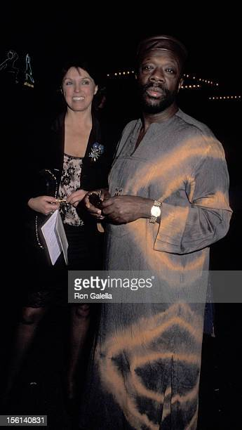 Musician Isaac Hayes and date attend Red Cross Benefit for Kosovo Relief on May 3 1999 at the Kit Kat Club in New York City