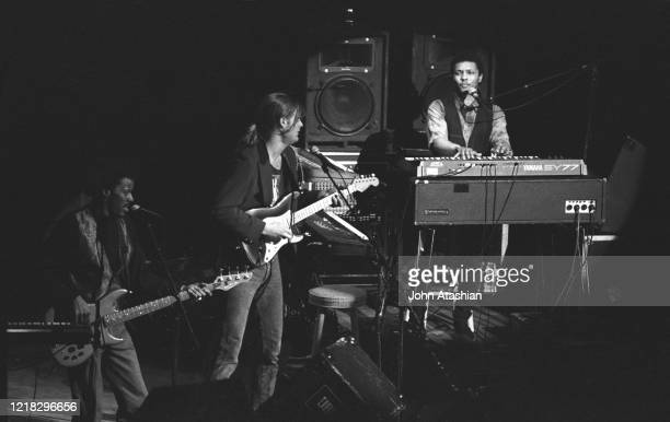 """Musician Ivan Neville is shown performing on stage during a """"live"""" concert appearance with his solo band on April 12, 1991."""
