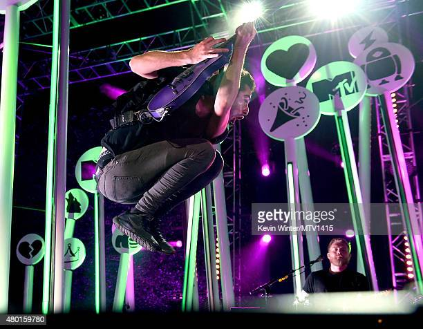 Musician Jack Barakat of All Time Low performs onstage during the MTV Fandom Fest San Diego ComicCon at PETCO Park on July 9 2015 in San Diego...