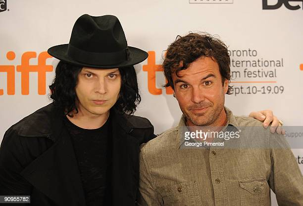 Musician Jack White and director Emmett Malloy pose onstage at the 'White Stripes Under The Great White Northern Lights' press conference held at the...