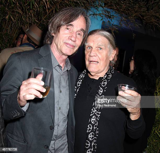 Musician Jackson Browne and photographer Henry Diltz attend iconic rock photographer Danny Clinch exhibition opening at Morrison Hotel Gallery on...