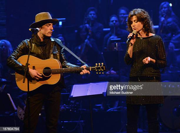 Musician Jakob Dylan and singer Amy Grant perform onstage during a celebration of Carole King and her music to benefit Paul Newman's The Painted...