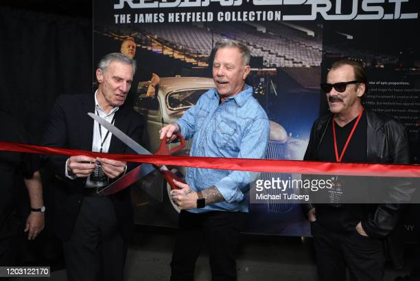 """Musician James Hetfield of Metallica cuts the ribbon opening his custom automobile exhibit """"Reclaimed Rust: The James Hetfeild Collection"""" at..."""