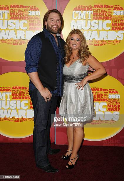 Musician James Otto and Amy Otto attend the 2011 CMT Music Awards at the Bridgestone Arena on June 8 2011 in Nashville Tennessee