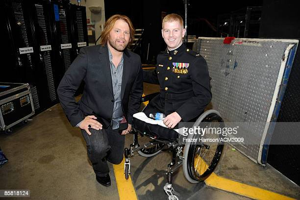 Musician James Otto and Lt Andrew Kinard pose backstage during the 44th annual Academy Of Country Music Awards held at the MGM Grand on April 5 2009...