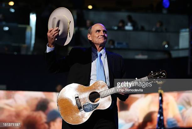 Musician James Taylor performs walks on stage during the final day of the Democratic National Convention at Time Warner Cable Arena on September 6...