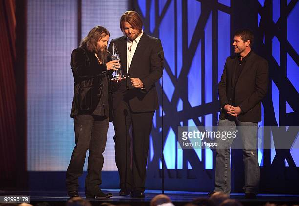 Musician Jamey Johnson accepts the award for Song of the Year with James Otto and Lee Thomas Miller onstage during the 43rd Annual CMA Awards at the...