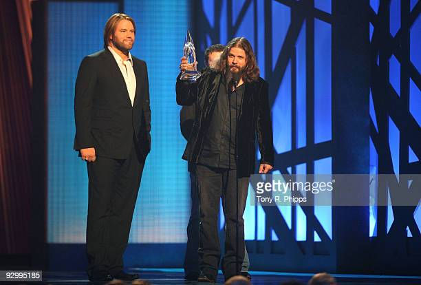 Musician Jamey Johnson accepts the award for Song of the Year with James Otto onstage during the 43rd Annual CMA Awards at the Sommet Center on...