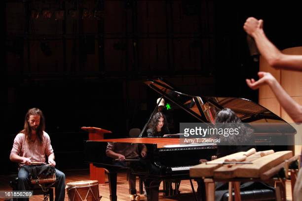 Musician Jamixel Bereau of the Kalakan Trio practices his percussion instruments during rehearsal with French sisters concert pianists Katia Labeque...