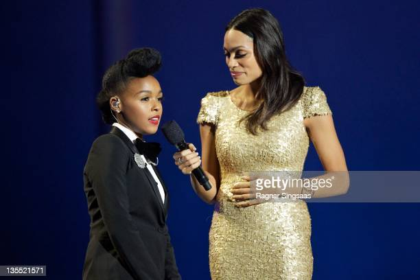 Musician Janelle Monae and hostess Rosario Dawson speak during the Nobel Peace Prize Concert at Oslo Spektrum on December 11 2011 in Oslo Norway