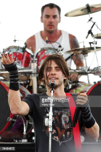 Musician Jared Leto performs with his band 30 Seconds to Mars prior to the NASCAR Nextel Cup Series Sharp Aquos 500 at California Speedway on...