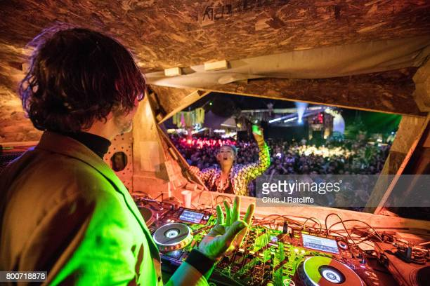 Musician Jarvis Cocker plays a DJ set from a wooden tree structure in the Greenpeace are at Glastonbury Festival Site on June 25 2017 in Glastonbury...