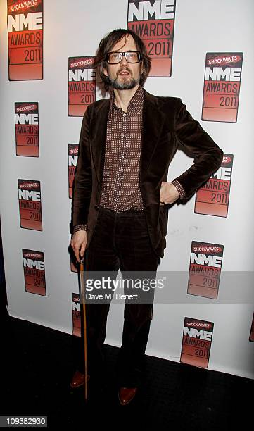 Musician Jarvis Cocker poses against the Shockwaves NME Awards 2011 winners boards at Brixton Academy on February 23 2011 in London England