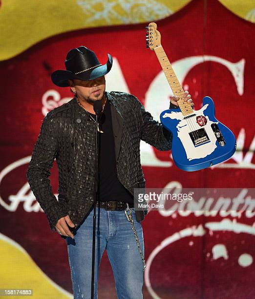 Musician Jason Aldean accepts the Touring Artist of the Year award onstage during the 2012 American Country Awards at the Mandalay Bay Events Center...