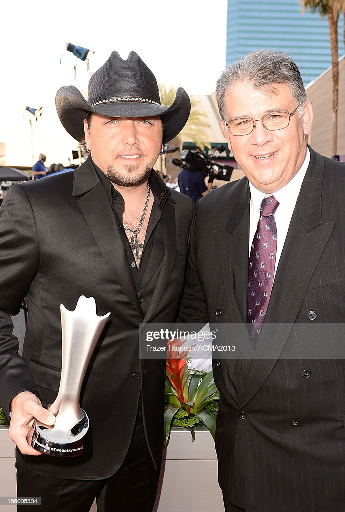 Musician Jason Aldean and Academy of Country Music CEO Bob Romeo attend the 48th Annual Academy of Country Music Awards at the MGM Grand Garden Arena on April 7, 2013 in Las Vegas, Nevada.