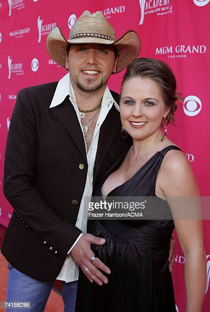 Musician Jason Aldean and his wife Jessica arrive at the 42nd Annual Academy Of Country Music Awards held at the MGM Grand Garden Arena on May 15,...