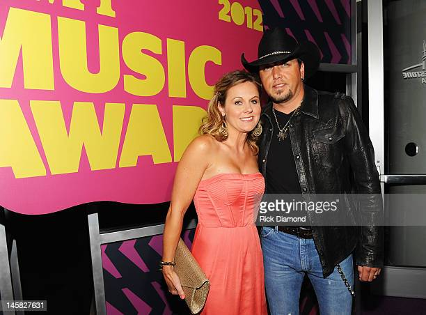 Musician Jason Aldean and Jessica Aldean arrive at the 2012 CMT Music awards at the Bridgestone Arena on June 6 2012 in Nashville Tennessee
