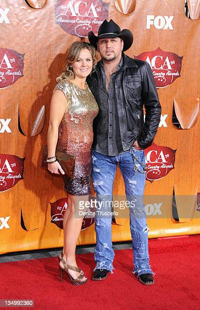 Musician Jason Aldean and Jessica Aldean arrives at 2011 American Country Awards at MGM Grand Garden Arena on December 5, 2011 in Las Vegas, Nevada.