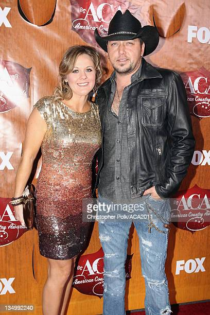 Musician Jason Aldean and Jessica Aldean arrives at the American Country Awards 2011 at the MGM Grand Garden Arena on December 5, 2011 in Las Vegas,...