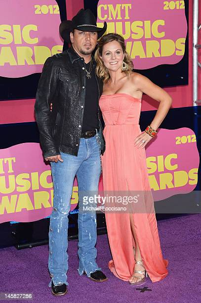 Musician Jason Aldean and wife Jessica Aldean arrive at the 2012 CMT Music awards at the Bridgestone Arena on June 6, 2012 in Nashville, Tennessee.