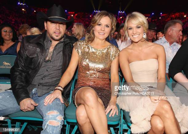 Musician Jason Aldean, Jessica Aldean and Singer Carrie Underwood attends the American Country Awards 2011 at the MGM Grand Garden Arena on December...