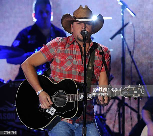 Musician Jason Aldean performs onstage during the American Country Awards 2010 held at the MGM Grand Garden Arena on December 6, 2010 in Las Vegas,...