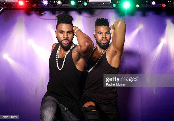 Musician Jason Derulo poses with his wax figure during Madame Tussauds Hollywood unveiling of Singer/Songwriter and Dancer Jason DeRulo immortalized...