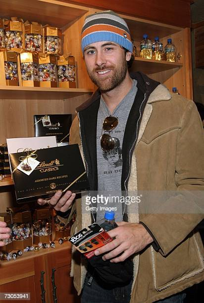 Musician Jay Nash poses with 180's gloves Lindt and Fiji Water displays at the Gibson Guitar and Entertainment Tonight celebrity hospitality lodge in...