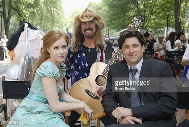 Musician Jeff Watson actress Amy Adams and actor Patrick Dempsey pose during the filming of Walt Disney Pictures Enchanted in Central Park on July 10...