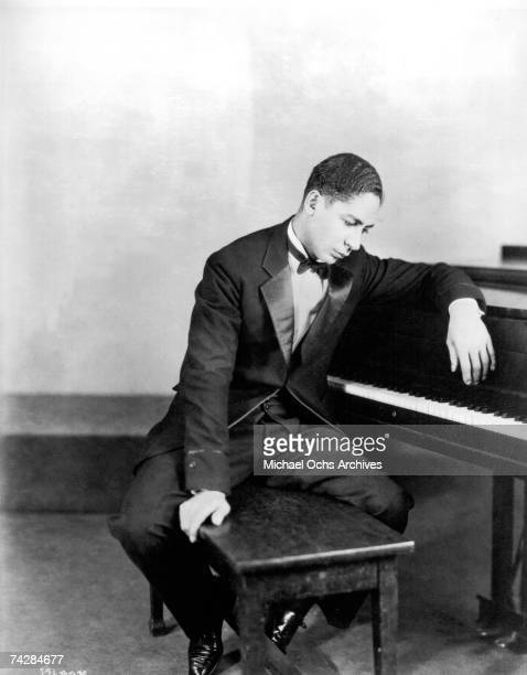 Musician Jelly Roll Morton poses for a portrait at the piano in circa 1923 in Chicago