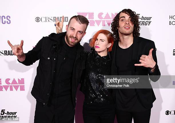 Musician Jeremy Davis singer Hayley Williams and musician Taylor York of Paramore pose backstage during CBS Radio's We Can Survive at the Hollywood...
