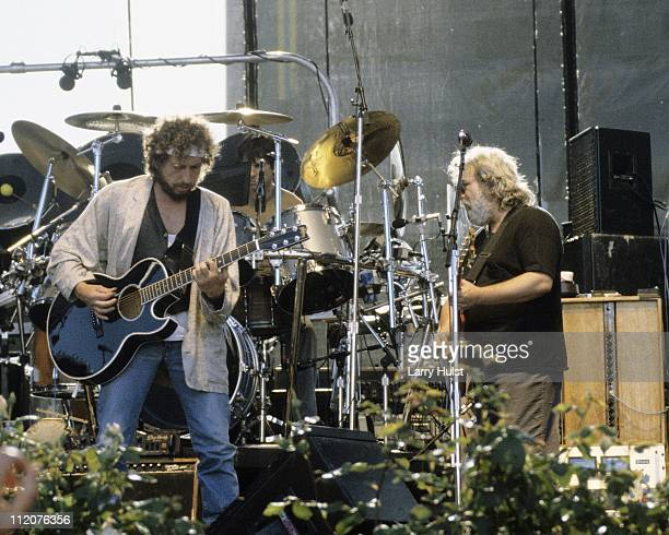 Musician Jerry Garcia and Bob Dylan and the Grateful Dead performing at Autzen Stadium in Eugene Oregon on July 19 1987