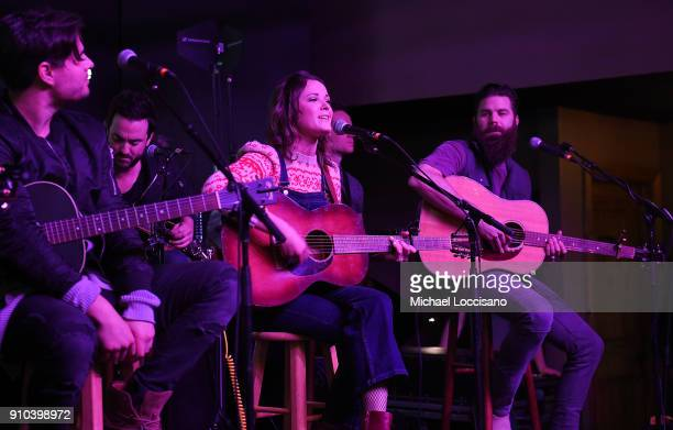 Musician Jillian Jacqueline performs for the CMA Songwriters Series while musicians Steven Lee Olsen and Jordan Davis look on during the 2018...