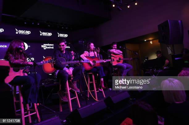 Musician Jillian Jacqueline performs for the CMA Songwriters Series while musicians Tenille Townes Steven Lee Olsen and Jordan Davis look on during...