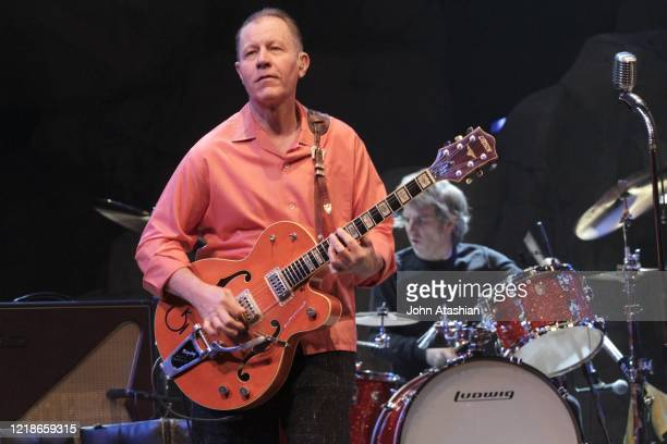"""Musician Jim Heath is shown performing on stage during a """"live"""" concert appearance with The Reverend Horton Heat on April 5, 2013."""