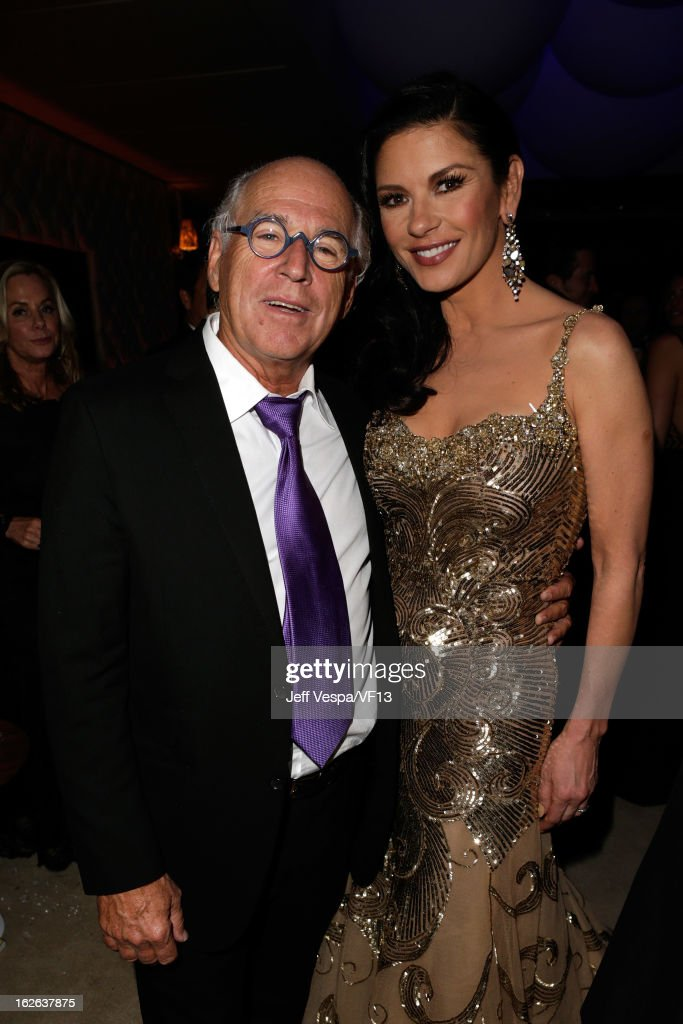 Musician Jimmy Buffet (L) and actress Catherine Zeta Jones attend the 2013 Vanity Fair Oscar Party hosted by Graydon Carter at Sunset Tower on February 24, 2013 in West Hollywood, California.