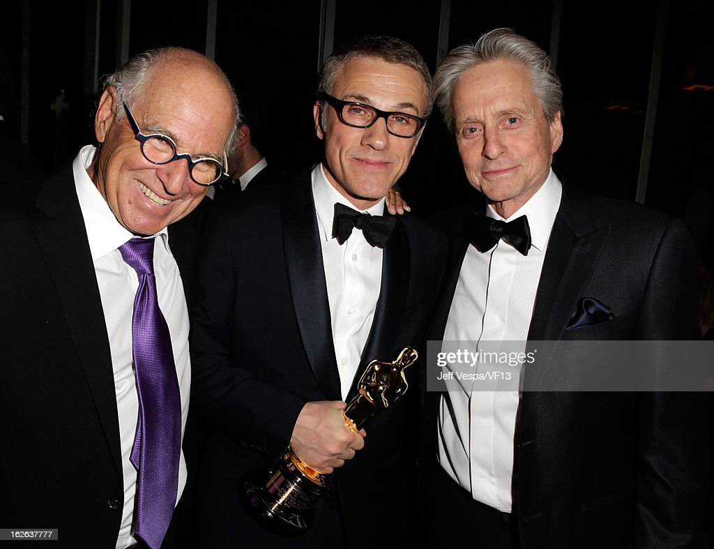 Musician Jimmy Buffett, actors Christoph Waltz, and Michael Douglas attend the 2013 Vanity Fair Oscar Party hosted by Graydon Carter at Sunset Tower on February 24, 2013 in West Hollywood, California.