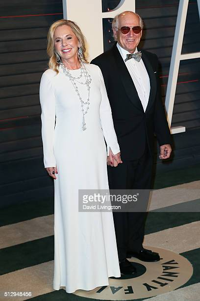 Musician Jimmy Buffett and Jane Slagsvol arrive at the 2016 Vanity Fair Oscar Party Hosted by Graydon Carter at the Wallis Annenberg Center for the...