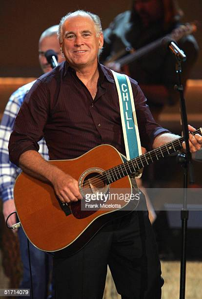 Musician Jimmy Buffett performs on stage at the 38th Annual CMA Awards at the Grand Ole Opry House November 9 2004 in Nashville Tennessee