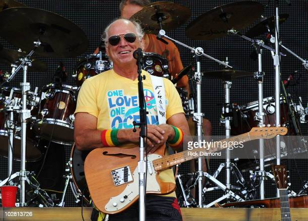 Musician Jimmy Buffett performs onstage at Jimmy Buffett Friends Live from the Gulf Coast a concert presented by CMT at on the beach on July 11 2010...