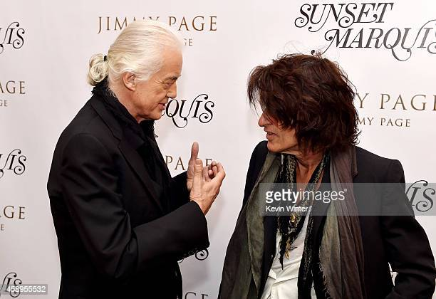 Musician Jimmy Page and Joe Perry talk at a private reception and dinner for Jimmy Page to celebrate his new autobiography Jimmy Page by Jimmy Page...