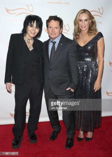 Musician Joan Jett actors Michael J Fox and Tracy Pollan attend the 2019 A Funny Thing Happened On The Way To Cure Parkinson's at the Hilton New York...