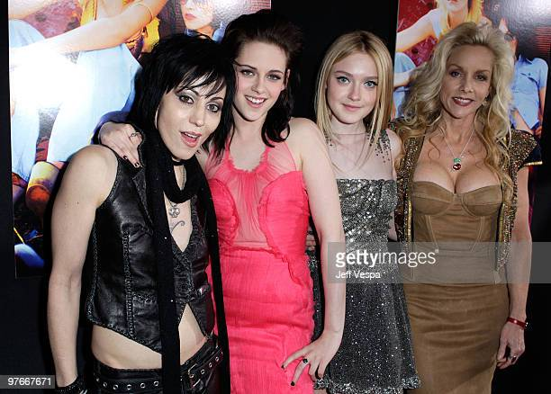 Musician Joan Jett actress Kristen Stewart actress Dakota Fanning and musician Cherie Currie arrive at the Los Angeles Premiere of The Runaways...