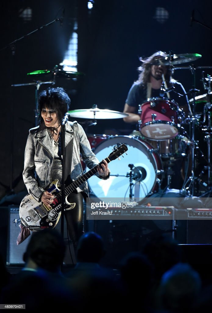 Musician Joan Jett (L) performs onstage with Dave Grohl of Nirvana at the 29th Annual Rock And Roll Hall Of Fame Induction Ceremony at Barclays Center of Brooklyn on April 10, 2014 in New York City.
