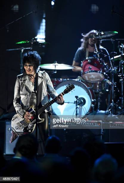 Musician Joan Jett performs onstage with Dave Grohl of Nirvana at the 29th Annual Rock And Roll Hall Of Fame Induction Ceremony at Barclays Center of...