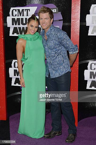 Musician Joe Don Rooney and wife Tiffany Fallon attend the 2013 CMT Music awards at the Bridgestone Arena on June 5 2013 in Nashville Tennessee
