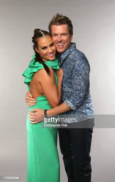 Musician Joe Don Rooney and wife Tiffany Fallon pose at the Wonderwall portrait studio during the 2013 CMT Music Awards at Bridgestone Arena on June...